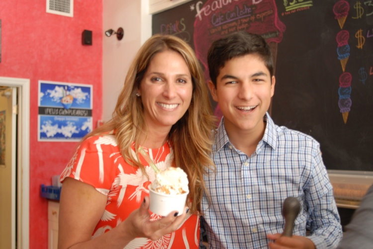 Suzy Batlle, owner of ¡Azucar! with son.