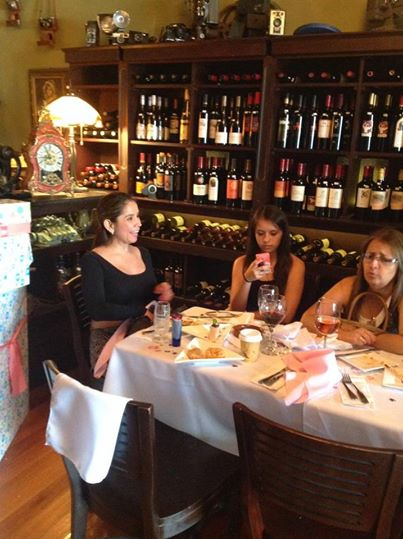 Chef Betty (left) sits with patrons at Le Koke Wine and Bites in Little Havana
